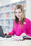 Pretty, female student with laptop and books Stock Image