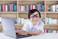 Pretty Female Student with A Laptop Stock Images