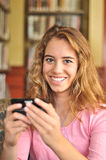 Pretty Female Student Reads a text message royalty free stock images