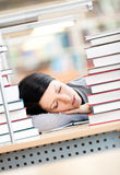Pretty female student sleeping at the desk royalty free stock photography