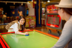 Pretty female students going to the playground. Asian pretty female students going to the playground playing the table hockey game with sister friends after Royalty Free Stock Images