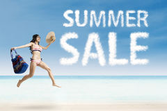 Pretty female with summer sale cloud Stock Images