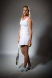 Pretty female tennis player Stock Image