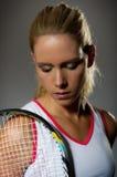 Pretty female tennis player Stock Photo