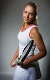 Pretty female tennis player Stock Images