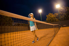 Pretty female tennis player at court Stock Image
