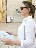 Pretty female tourist. Pretty female tourist with city map royalty free stock photography