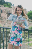 Pretty female tourist looking a map on the ruins of the Roman Fo Royalty Free Stock Image
