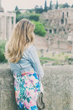 Pretty female tourist on the ruins of the Roman Forum in Rome, I Stock Photography