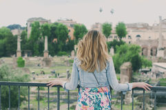 Pretty female tourist on the ruins of the Roman Forum in Rome, I Stock Image