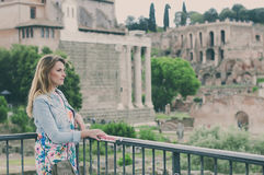 Pretty female tourist on the ruins of the Roman Forum in Rome, I Royalty Free Stock Photos