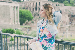 Pretty female tourist on the ruins of the Roman Forum in Rome, I Royalty Free Stock Photography