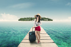 Pretty female tourist standing on jetty Stock Images