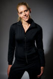 Pretty female in trach suit Stock Photo