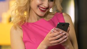 Pretty female typing message on phone, socializing with friends, communication. Stock footage stock video footage