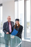 Pretty female university graduate. With her happy and proud father, moments after getting the diploma Royalty Free Stock Photos