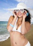 Pretty female wearing a bikini and sun hat royalty free stock photo
