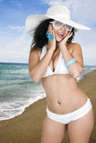 Pretty female wearing a bikini and sun hat stock photography