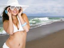 Pretty female wearing a bikini and sun hat royalty free stock image