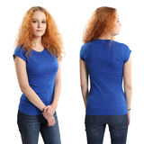 Pretty female wearing blank blue shirt Stock Images