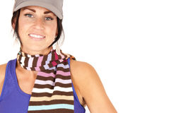 Pretty female wearing hat and colorful striped sca Royalty Free Stock Photo