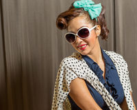 Pretty female wearing sunshades and retro style Royalty Free Stock Photos