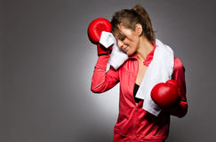 Pretty female wiping her face after workout royalty free stock photos