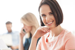 Pretty female worker is expressing positive emotions stock photos