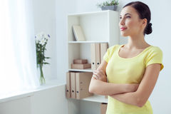 Pretty female worker is expressing positive emotions stock photography