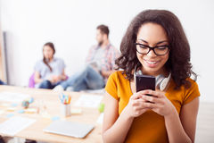 Pretty female worker is using a telephone Royalty Free Stock Images