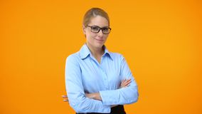 Pretty female worker winking camera folding arms, professional company employee. Stock footage stock video