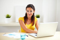 Pretty female working as a receptionist in company Stock Photography