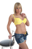 Pretty female in yellow lingerie and shorts Royalty Free Stock Photos