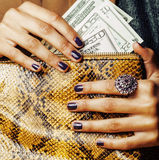Pretty fingers of african american woman holding Stock Images