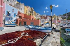 Fishing village, colourful fishermen`s houses, and fishing nets, Marina Corricella Procida Island, Bay of Naples, Italy. Pretty fishing village, colourful royalty free stock photos