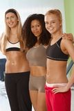 Pretty fit girls. Embracing at the gym Stock Photography