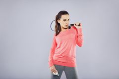 Pretty fit woman holding badminton racket Royalty Free Stock Photos