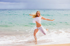 Pretty Fit Woman running in the water Royalty Free Stock Photo
