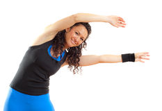 Pretty fitness girl stretching, smiling Royalty Free Stock Images