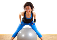 Pretty fitness girl with weights and ball Royalty Free Stock Photo
