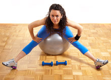 Pretty fitness girl with weights and ball Royalty Free Stock Photos