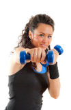 Pretty fitness girl with weights, smiling Stock Images