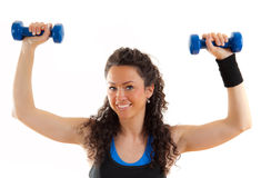 Pretty fitness girl with weights, smiling Stock Photography