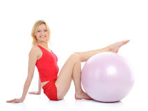 Pretty fitness woman exercise with pilates ball Stock Image