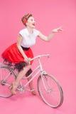 Pretty flirty female bicyclist has a fun Royalty Free Stock Images