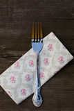 Pretty floral napkin with a silver fork Stock Photo