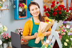 Pretty flower shop owner Stock Images