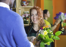 Pretty Flower Shop Owner and Customer Stock Photo