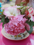 Pretty flower table decoration. On pink table Stock Photo