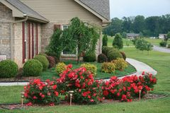 Pretty Flowerbed. Nice landscaping around a newer home stock photo